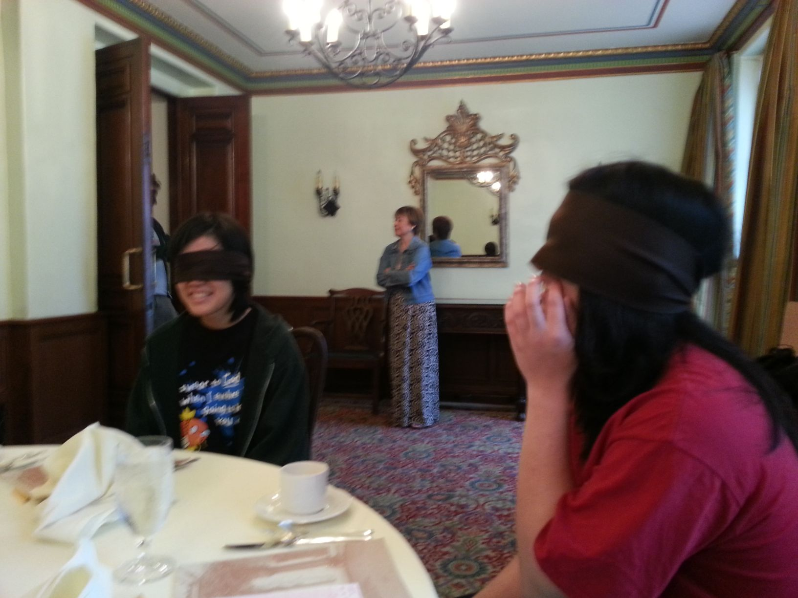 Still blindfolded, we're taken to a mysterious room and a mysterious table.